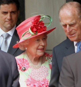 Queen Elizabeth II and Prince Philip, Duke of Edinburgh leaving the Royal York hotel in Toronto on a tour of Canada in 2010.
