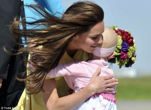 The Duchess of Cambridge embracing Diamond Marshall during her 2011 tour of Canada