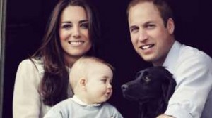 The Duke and Duchess of Cambridge, Prince George and family dog Lupo in the window of their apartment at Kensington Palace.