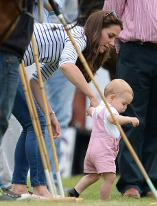 Prince George and the Duchess of Cambridge at the polo match. Photo credit: Splash news