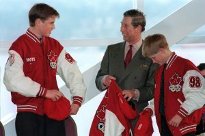 (VCR 112) VANCOUVER, Mar.24--Prince William (Left) and his father Prince Charles and brother Prince Harry (Right) try on jackets and hats from the Canadian Olympic Team Uniform after being presented with them at a environmental heritage event in Vancouver Tuesday. (CP PHOTO) 1998 (stf-Chuck Stoody)fng